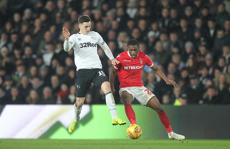 Derby County's Tom Lawrence in action with Nottingham Forest's Tendayi Darikwa<br /> <br /> Photographer Mick Walker/CameraSport<br /> <br /> The EFL Sky Bet Championship - Derby County v Nottingham Forest - Monday 17th December 2018 - Pride Park - Derby<br /> <br /> World Copyright © 2018 CameraSport. All rights reserved. 43 Linden Ave. Countesthorpe. Leicester. England. LE8 5PG - Tel: +44 (0) 116 277 4147 - admin@camerasport.com - www.camerasport.com