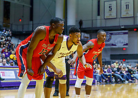 Stony Brook defeats UAlbany  69-60 in the America East Conference tournament quaterfinals at the  SEFCU Arena, Mar. 3, 2018.  Tyrell Sturdivant (#12), Alex Foster (#34) and Jaron Cornish (#0) await a foul shot.