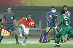 07 August 2008: Jonathan De Guzman (NED) (7) controls the ball in front of Chibuzor Okonkwo (NGA) (2).  The men's Olympic soccer team of the Netherlands played the men's Olympic soccer team of Nigeria at Tianjin Olympic Center Stadium in Tianjin, China in a Group B round-robin match in the Men's Olympic Football competition.