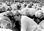 Coach Bobby Bowden holds a prayer meeting with his players at the 1984 FSU-Miami game in the Orange Bowl.  The Bowden led Seminoles went in to the Orange Bowl and crushed a Bernie Kosar and Vinny Testaverde  quarterbacked defending national championship Miami team 38-3.