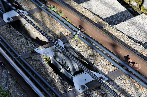 Switzerland, Western Europe, Grimsel region, nr. Guttannen, Gelmerbahn funicular. Track and pulling cable. Note: No releases available. --- Info: The Gelmer cable car funicular railway with a maximum incline of 106 percent is Europe's steepest cable car. The Gelmer Railway was built in the 1920s to help with the construction of the Lake Gelmer water reservoir dam. Originally used for freight the cable car was converted to a passenger railway in 2001. The 12 minutes and one kilometer long ride in the open carriages overcomes a 450 meters height difference and takes one up to Lake Gelmer at an altitude of 1860 meters above sea level. The region where the reservoir is located is the starting point for hikes and mountain tours.