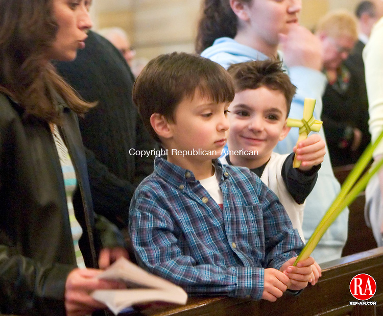 WATERBURY, CT - 09 APRIL 2006 -040906JT01--<br /> Jake Murtishi, 4, shows Michael Trinkely, also 4, a palm leaf shaped into a cross while Trinkely holds unfolded leaves and Trinkely's mother, Lana Goncalves, tries to quiet the boys at the beginning of Mass at the Church of the Immaculate Conception in Waterbury on Palm Sunday.<br /> Josalee Thrift Republican-American