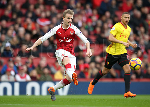 11th March 2018, Emirates Stadium, London, England; EPL Premier League Football, Arsenal versus Watford; Rob Holding of Arsenal passing the ball through midfield