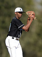 Olympia Titans starting pitcher Juan Hillman (18) during a game against the Orangewood Christian Rams at Olympia High School on February 19, 2014 in Olympia, Florida.  (Mike Janes/Four Seam Images)