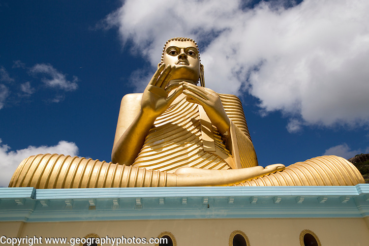 Giant Golden Buddha statue at Dambulla cave temple complex, Sri Lanka, Asia