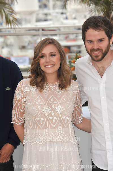 "Elizabeth Olsen & Sean Durkin at the photocall for their movie ""Martha Marcy May Marlene"" at the 64th Festival de Cannes..May 15, 2011  Cannes, France.Picture: Paul Smith / Featureflash"