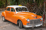 Finca La Vigia, San Francisco de Paula, Cuba; a classic orange colored 1946 Dodge parked near the Hemingway Museum