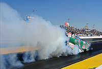 Feb. 17 2012; Chandler, AZ, USA; NHRA funny car driver John Force does a burnout during qualifying for the Arizona Nationals at Firebird International Raceway. Mandatory Credit: Mark J. Rebilas-