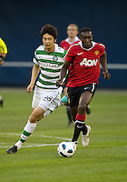 16 July 2010 Manchester United Danny Welbeck No.19 and Celtic FC Ki Sung Yueng No. 18 in action during an international friendly  between Manchester United and Celtic FC at the Rogers Centre in Toronto..Manchester United won 3-1.