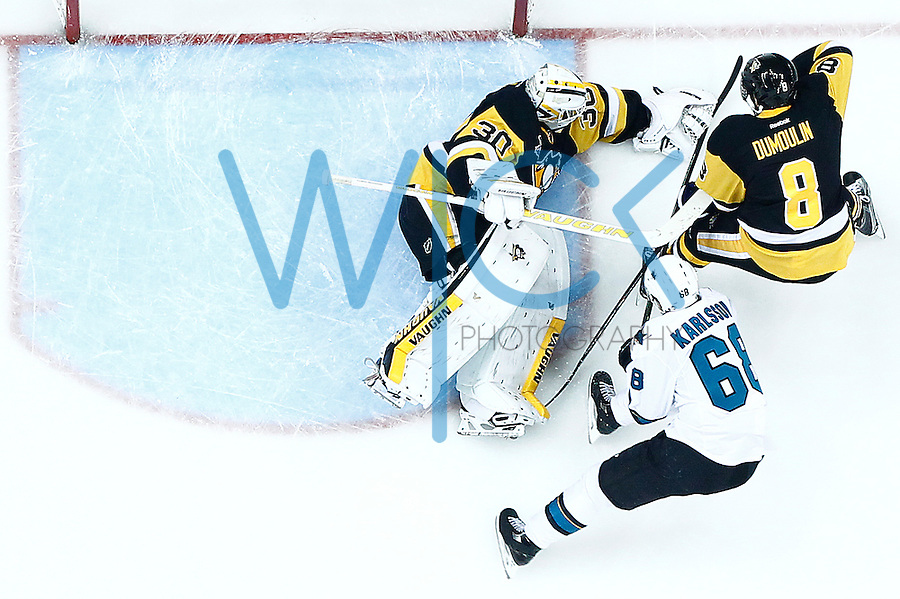 Matt Murray #30 of the Pittsburgh Penguins makes a save on Melker Karlsson #68 of the San Jose Sharks in the first period during game five of the Stanley Cup Final at Consol Energy Center in Pittsburgh, Pennsylvania on June 9, 2016. (Photo by Jared Wickerham / DKPS)
