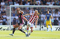 Leeds United's Kalvin Phillips and Stoke City's Nathan Collins<br /> <br /> Photographer Stephen White/CameraSport<br /> <br /> The Premier League - Stoke City v Leeds United - Saturday August 24th 2019 - bet365 Stadium - Stoke-on-Trent<br /> <br /> World Copyright © 2019 CameraSport. All rights reserved. 43 Linden Ave. Countesthorpe. Leicester. England. LE8 5PG - Tel: +44 (0) 116 277 4147 - admin@camerasport.com - www.camerasport.com