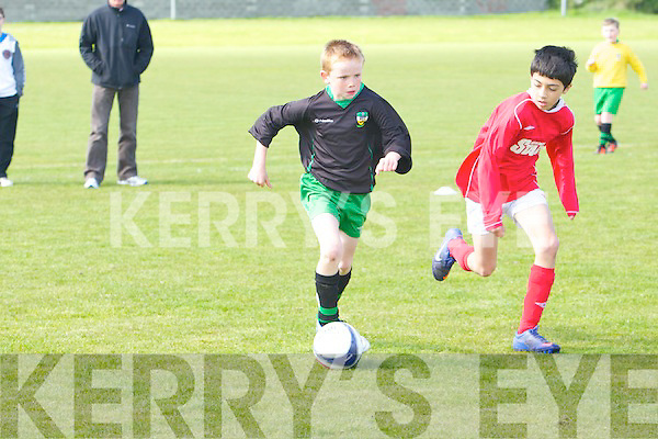 Kingdom Boys John Carmody gets away from St Brendan's Park's Aci Gardici in the U11 Kerry Cup semi-final at Christy Leahy park, Tralee on Saturday.
