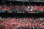 11 February 2006: Korean and Costa Rican fans, both in red, await the opening kickoff. The Costa Rica Men's National Team defeated South Korea 1-0 at McAfee Coliseum in Oakland, California in an International Friendly soccer match.