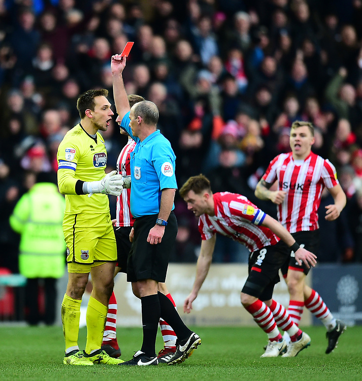Grimsby Town's James McKeown is shown a red card by referee Mike Dean<br /> <br /> Photographer Andrew Vaughan/CameraSport<br /> <br /> The EFL Sky Bet League Two - Lincoln City v Grimsby Town - Saturday 19 January 2019 - Sincil Bank - Lincoln<br /> <br /> World Copyright © 2019 CameraSport. All rights reserved. 43 Linden Ave. Countesthorpe. Leicester. England. LE8 5PG - Tel: +44 (0) 116 277 4147 - admin@camerasport.com - www.camerasport.com