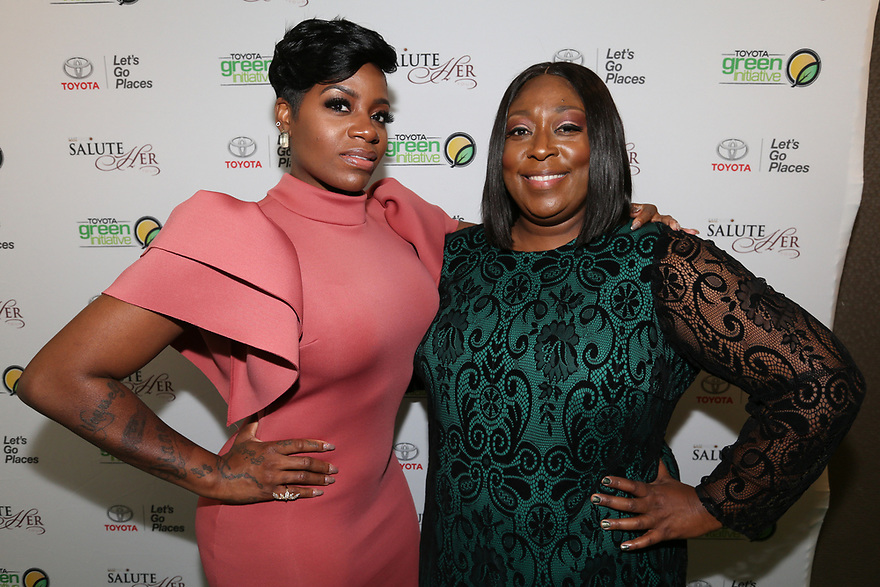 Soul Solidarity Award Honoree Fantasia Barrino-Tyalor and host Loni Love attend the Salute Her Awards sponsored by Toyota and AARP in Charlotte.