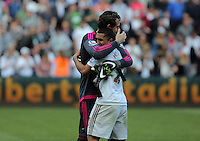( L-R ) Kristoffer Nordfeldt of Swansea City hugs team mate Jefferson Montero after the English Premier League game at the Liberty Stadium, Swansea, Wales, UK, Sunday 15 May 2016. EPA/DIMITRIS LEGAKIS <br /> EDITORIAL USE ONLY. No use with unauthorized audio, video, data, fixture lists, club/league logos or 'live' services. Online in-match use limited to 75 images, no video emulation. No use in betting, games or single club/league/player publications