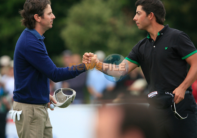 Pablo Larrazabal (ESP) and Thomas Aiken (RSA) finish their round on the 18th green during Day 3 of the Open de Espana at Real Club De Golf El Prat, Terrasa, Barcelona, 7th May 2011. (Photo Eoin Clarke/Golffile 2011)