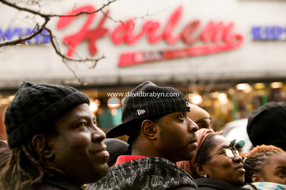"""28 December 2006 - New York City, NY - People was a video of James Brown on a monitor as they line up outside the Apollo theater on 125th street in Harlem, New York City, USA, to see the body of singer James Brown lying in wake inside. Brown, known as the """"Godfather of Soul"""" died on Christmas Day."""