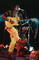 Mali. Bamako. The musician Habib Koite plays the guitar and sings during a concert at Mamadou Konate stadium. © 1997 Didier Ruef