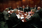 United States President George W. Bush meets with his National Security Council  in the White House Situation Room in Washington, D.C. on October 2, 2001.  From left: United States Secretary of State Colin Powell, United States Secretary of Defense Donald Rumsfeld, National Security Advisor Condoleezza Rice, Director, Central Inteliigence (CIA) George Tenet, White House Chief of Staff Andy Card, United States Vice President Dick Cheney, and United States President George W. Bush.  Also visible in the background, from left are Deputy National Security Advisor Steven Hadley, and the Vice President's Chief of Staff Lewis Libby.<br /> Mandatory Credit: Eric Draper / White House via CNP