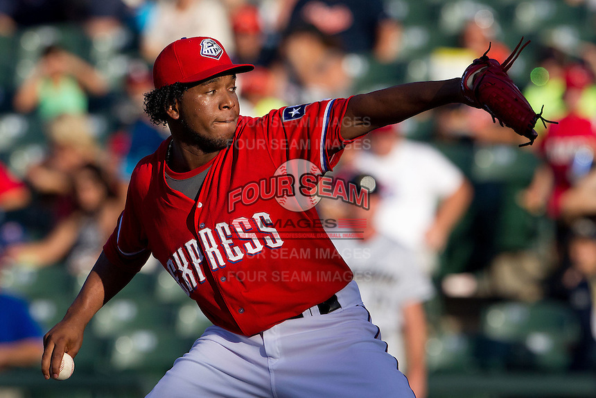 Texas Rangers pitcher Neftali Feliz #58 delivers during a rehab start with the Pacific Coast League Round Rock Express. Feliz pitched 1.2 innings against Omaha Storm Chasers on July 20, 2012 at the Dell Diamond in Round Rock, Texas. The Chasers defeated the Express 10-4. (Andrew Woolley/Four Seam Images)