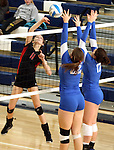 SIOUX FALLS, SD - NOVEMBER 5: Abbie Sell #11 from Brookings tips the ball past Jessica Mieras #22 and Dalee Stene #17 from O'Gorman in the third game of their District 1AA game Tuesday night at O'Gorman (Photo by Dave Eggen/Inertia)