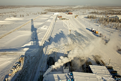 Achimgaz gas drilling well casts a shadow over the icy tundra in Novy Urengoi, Siberia, Russia.