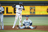 Wilmington Blue Rocks first baseman Nick Pratto (30) ends up sitting on the ground after trying to tag out Luis Robert (21) of the Winston-Salem Dash at BB&T Ballpark on April 16, 2019 in Winston-Salem, North Carolina. The Blue Rocks defeated the Dash 4-3. (Brian Westerholt/Four Seam Images)
