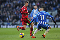 (L-R) Tom Carroll of Swansea City kicks the ball back past Anthony Knockaert of Brighton during the Premier League match between Brighton and Hove Albion and Swansea City and at the Amex Stadium, Brighton, England, UK. Saturday 24 February 2018