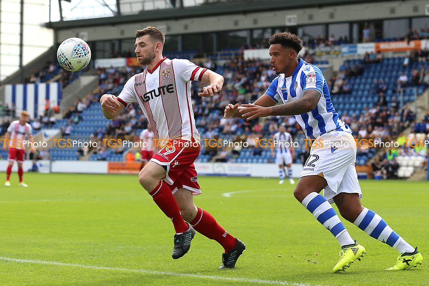 Danny Newton of Stevenage and Cole Kpekawa of Colchester United during Colchester United vs Stevenage, Sky Bet EFL League 2 Football at the Weston Homes Community Stadium on 12th August 2017