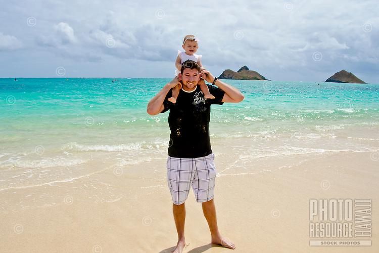 Dad Jason with baby Emma on his shoulders at Lanikai beach, Kailua, Oahu