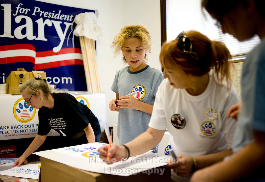 Hillary Clinton supporters, from left, Brenda Mullin (cq), Kayla Young (cq, age 12) Robin Purnell (cq), and Krysten Reyes (cq, age 8) halp paint signs at aPUMA PAC, People United Means Action, meeting at the Denver, Colorado, USA headquarters, Sunday, August 24, 2008. PUMA is working to support Hillary Clinton against Barack Obama who is scheduled to accept the nomination for president at the Democratic Nation Convention..PHOTOS/ MATT NAGER