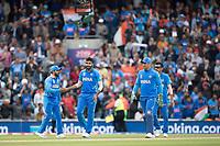 Kedar Jadhav (India) congratulates Jasprit Bumrah (India) on the wicket of Pat Cummins (Australia) during India vs Australia, ICC World Cup Cricket at The Oval on 9th June 2019