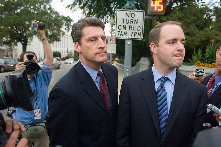 10/12/06--Kirk Fordham, right, a former chief of staff to former Rep. Mark Foley, R-Fla., and to National Republican Congressional Committee Chairman Thomas M. Reynolds, R-N.Y., waits for a cab outside the U.S. Capitol with attorney Tim Heaphy after he testified before the House ethics subcommittee investigating the handling of allegations involving inappropriate conduct toward congressional pages by Foley. Fordham was expected to tell the committee that he informed the office of Speaker J. Dennis Hastert, R-Ill., of problems with Foley three years ago. Foley resigned Sept. 29 after his sexually explicit communications with teenage former pages were made public. An evenly divided panel of two Republicans and two Democrats is examining the issues raised by the Foley matter. Congressional Quarterly Photo by Scott J. Ferrell