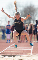 NWA Democrat-Gazette/CHARLIE KAIJO Sydney Suggs, 16, of Bentonville High long jumps during the Tiger Relays track meet, Friday, March 16, 2018 at the Tiger Athletic Complex in Bentonville.