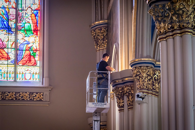 December 29, 2017; Workers install LED lighting in the Basilica of the Sacred Heart. (Photo by Matt Cashore)
