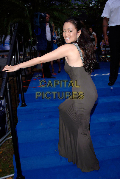 "GONG LI.European film premiere""Miami Vice"".Odeon cinema Leicester Square.27th July 2006 in London, England.Ref: FIN.full length brown green dress looking over shoulder.www.capitalpictures.com.sales@capitalpictures.com.©Steve Finn/Capital Pictures."