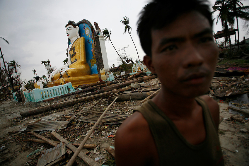 A Burmese man walks passed the fallen remains on a Buddhist temple on the banks of the Pyapon River in Piyapon (Irrawaddy Delta), Burma, Wednesday, May 7, 2008. Cyclone Nargis struck the Irrawaddy Delta region of Burma on May 4th/5th, leaving a path of destruction in its wake and killing approximately 130,000 people.