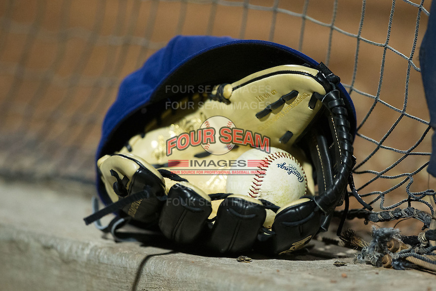 A Rawlings baseball sits in a glove in the Durham Bulls dugout during the International League game against the Scranton/Wilkes-Barre RailRiders at Durham Bulls Athletic Park on May 15, 2015 in Durham, North Carolina.  The RailRiders defeated the Bulls 8-4 in 11 innings.  (Brian Westerholt/Four Seam Images)