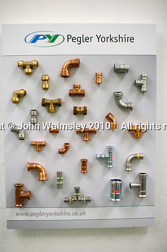 Display of pipe fittings at a plumbers' course, Able Skills, Dartford, Kent.