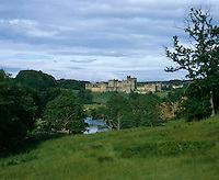 Alnwick Castle stands proud against the undulating landscape of Northumberland