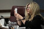 Nevada Assemblywoman Michele Fiore, R-Las Vegas, video tapes testimony in a hearing at the Legislative Building in Carson City, Nev., on Thursday, March 19, 2015. <br /> Photo by Cathleen Allison