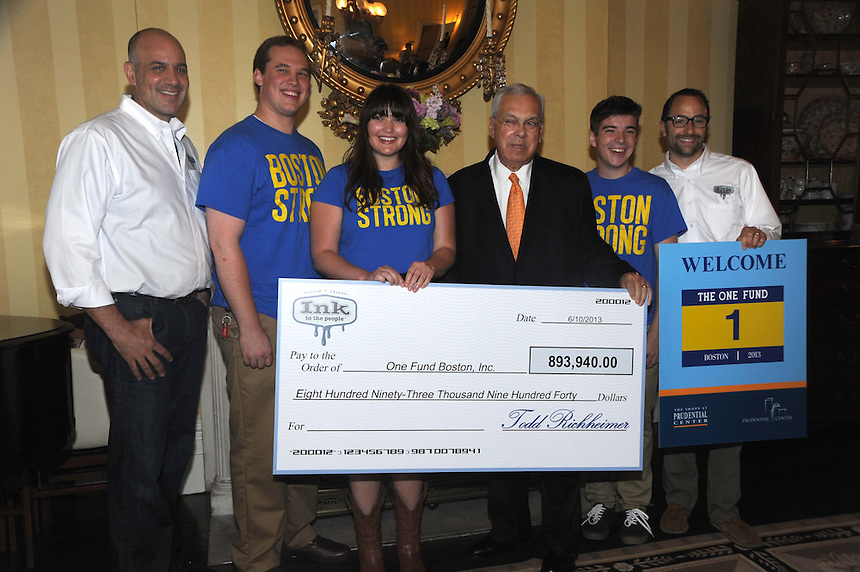 Boston Mayor Thomas Menino, third from right, accepts a check for The One Fund on June 11, 2013 from Emerson students who raised nearly $900,000 by creating and selling the Boston Strong T-shirts. From left, Jay Berman of T-shirt distributor Ink For the People, Nicholas Reynolds '14, Lane Brenner '13, Menino, Chris Dobens '16, and Todd Richeimer of Ink For The People. (Photo Courtesy of City of Boston.)