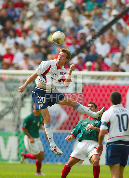 Brian McBride heads the ball against Mexico in the second round of play of the World Cup in Jeonju, Soth Korea, Monday June 17, 2002. Images provided in partnership with International Sports Images. (Please credit: John Todd/Int'l Sports Images/DSA)