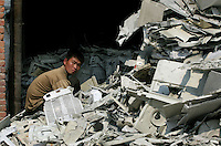 A worker sorts plastic e-waste in Guiyu in Guangdong province.