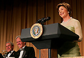 First lady Laura Bush steals the show during the annual White House Correspondents' Association dinner as she takes over the President's speech and makes the crowd, including U.S. President George W. Bush, left, and President of the White House Correspondents' Association Ron Hutcheson, erupt in laughter at the Washington Hilton in Washington, D.C., Saturday 30 April 2005. The annual dinner began in 1914 as a bridge between the White House and its media corps and tonight feautured a mix of political insiders including Supreme Court Justices, Antonin Scalia and Stephen Breyer, and Hollywood elite such as Goldie Hawn and Richard Gere. <br /> Credit: Katie Falkenberg - Pool via CNP