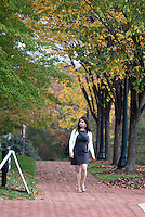 A student walking on grounds at the University of Virginia.