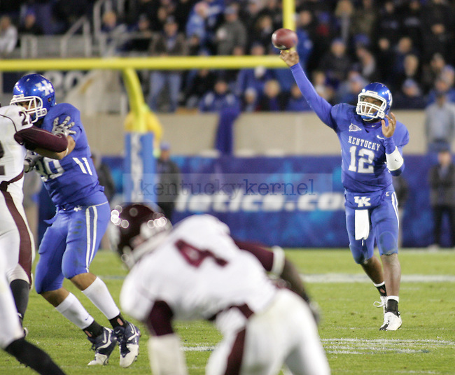 Kentucky quarterback Morgan Newton passes the ball in the second half of the game against Mississippi State at Commonwealth Stadium Saturday night. .Photo by Zach Brake | Staff