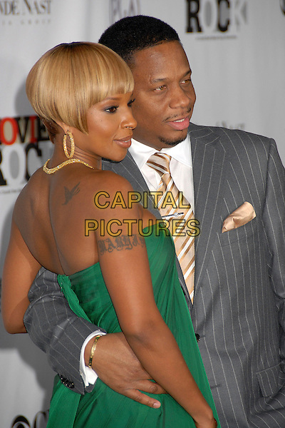 MARY J. BLIGE & KENDU ISAACS.2007 Movies Rock Celebration Presented by Conde Nast Media Group at the Kodak Theatre, Hollywood, California USA, 2 December 2007..half length green strapless tattoo back.CAP/ADM/BP.©Byron Purvis/AdMedia/Capital Pictures.