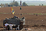 Israeli soldiers are seen relaxing in a field outside Gaza. In the first major clash since the cease fire, Hamas militants detonated a bomb near an Israeli jeep killing one soldier, to which the IDF has responded with aerial attacks in Gaza.<br /> Photo By: Eliyahu Ben Igal / JINI